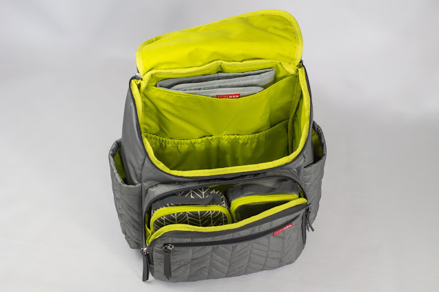 A top view of the Forma Backpack with the 2 main pockets open