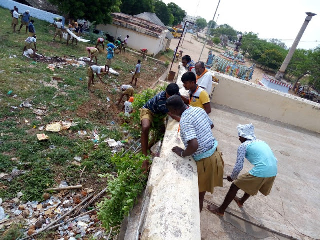 Cleaning temple premises by College students at Karur