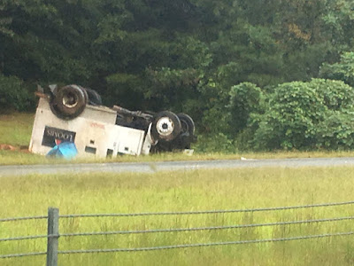 Two security officers injured when Loomis Armored Truck rolls over in NC