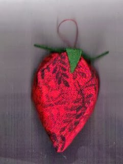 Red fabric Christmas ornament shaped like strawberry