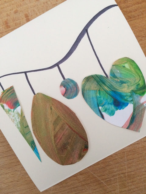 Hand made card with bauble shapes glued to it