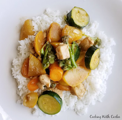rice topped with chicken and veggie stir fry