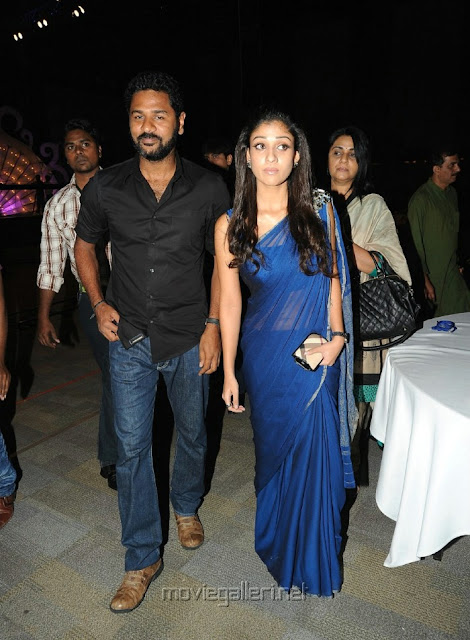 Nayanthara wearing Blue colour Georgette saree with stone brooch over the shoulder