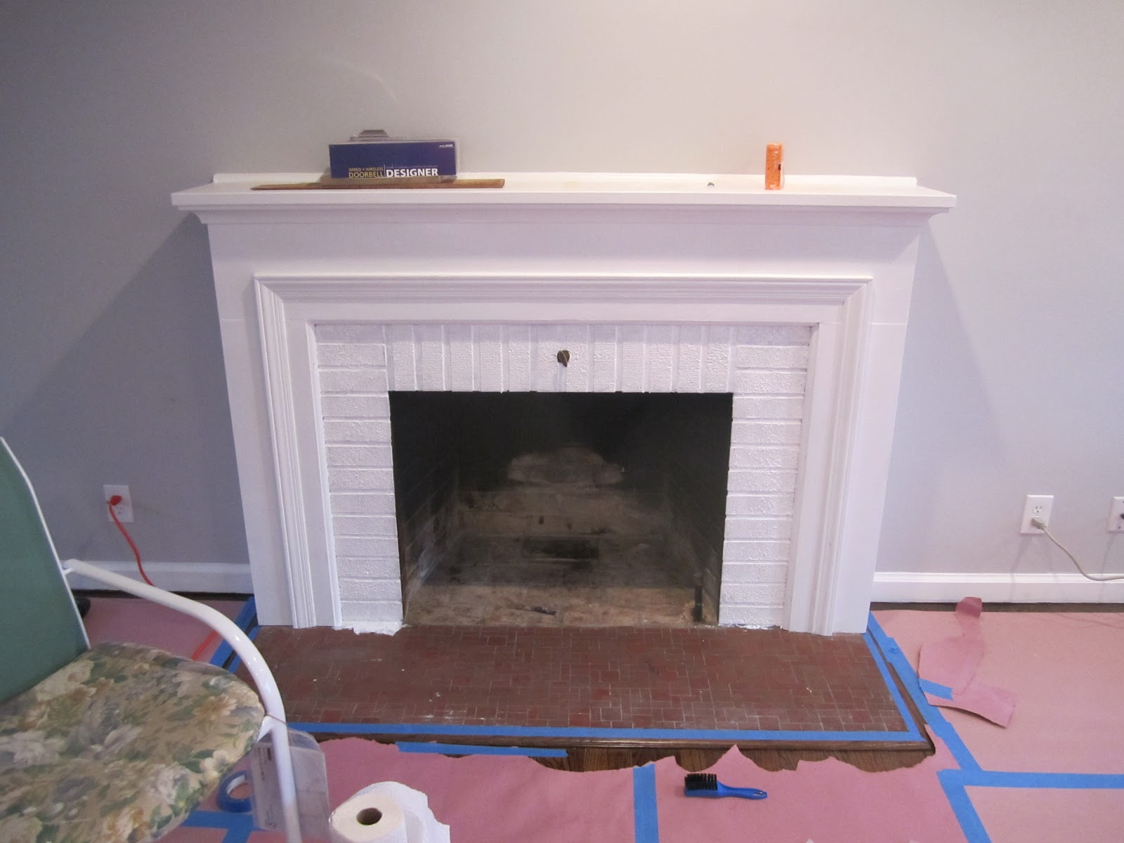 Retro ranch reno freshened up fireplace - Tiling a brick fireplace ...
