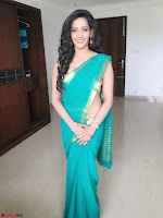 Sanjana Singh Looks Super cute in Green Saree Sleeveless Choli 7.JPG