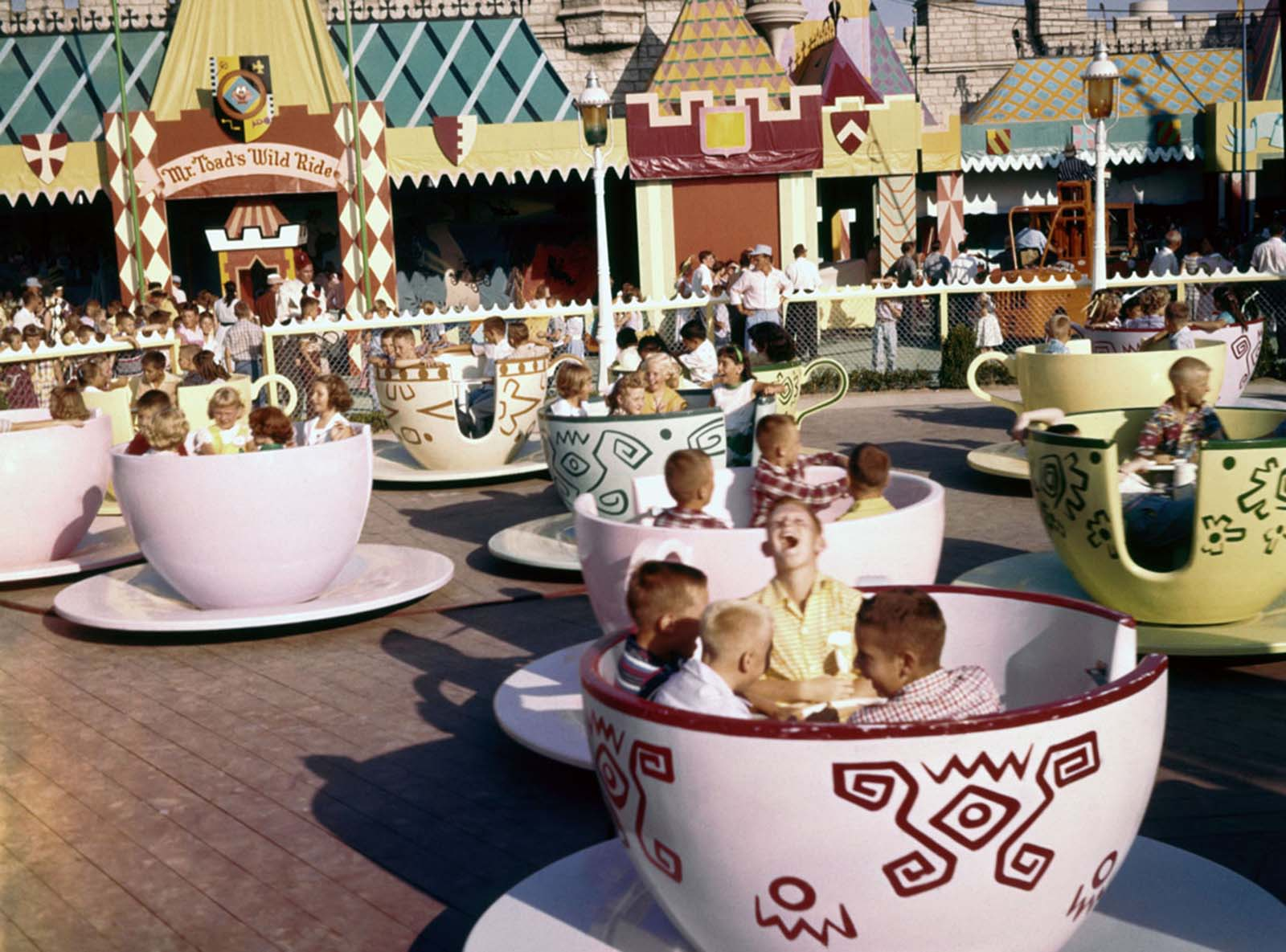 Visitors ride the Mad Hatter's Tea Party attraction in Fantasyland on July 17, 1955.