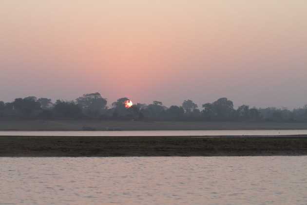 Sunrise over the Kabini Reservoir as seen during a morning boat safari