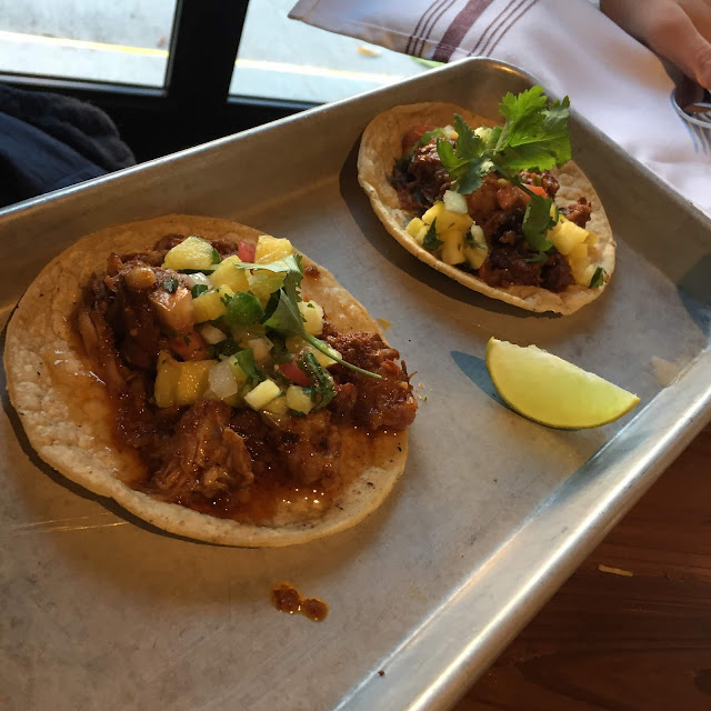 The Pork Al Pastor Tacos at truk't in Beloit, Wisconsin are so vibrant with pineapple on top!