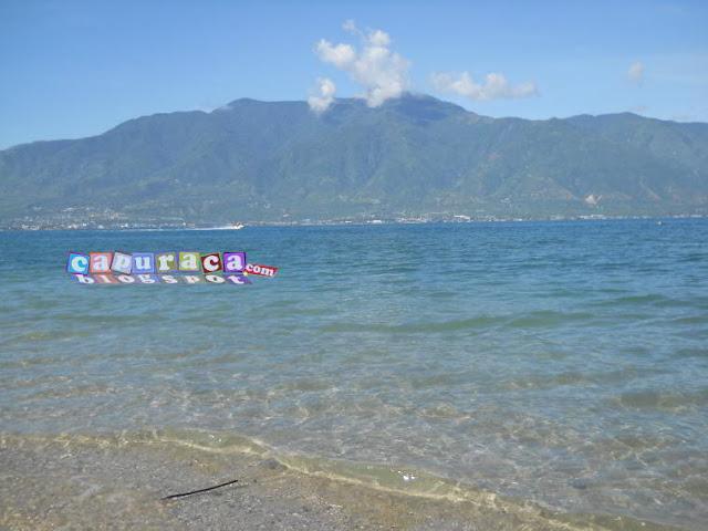 liburan ke pantai,liburan di pantai, pemandangan pantai