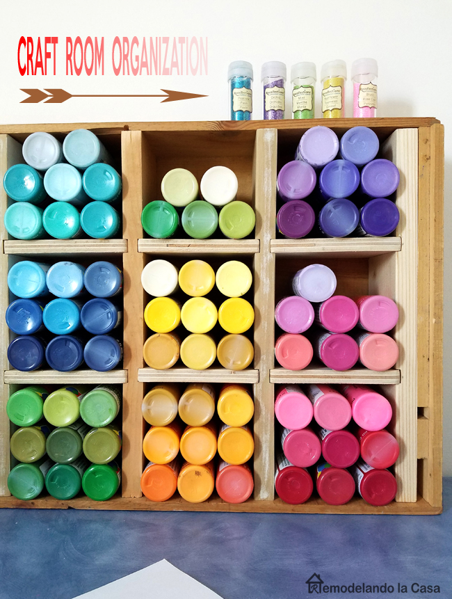 old wine crate repurposed into a craft paint storage box with lots of cubbies