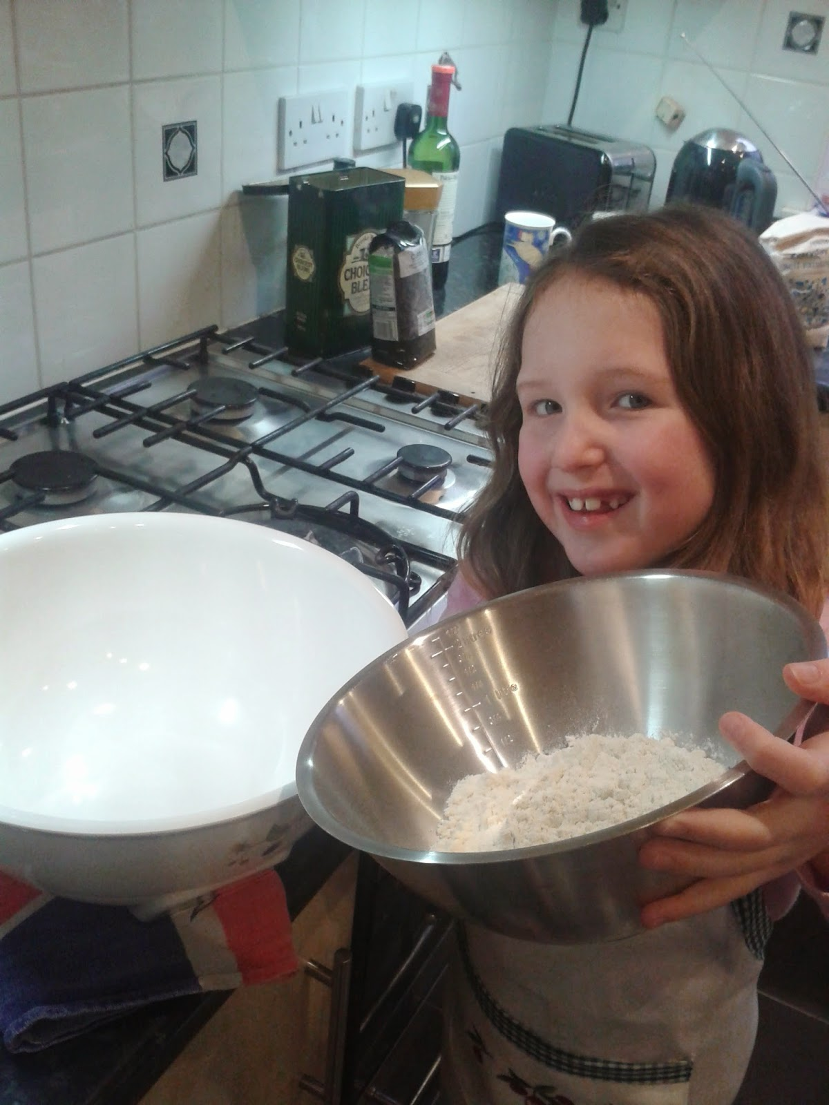 Welsh cakes recipe - Caitlin tipping flour into a mixing bowl