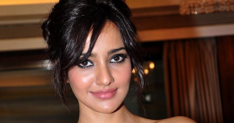 Actress Neha Sharma latest hot image gallery in black color outfits
