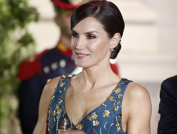 Queen Letizia wore a new floral-print v-neck sleeveless midi dress by Carolina Herrera.