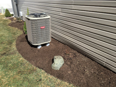 mulch around air conditioner