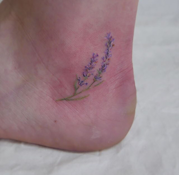 small lavender sprig tattoo on ankle