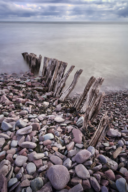 Coastal image of colourful rocks and old groyne at Porlock Weir by Martyn Ferry Photography