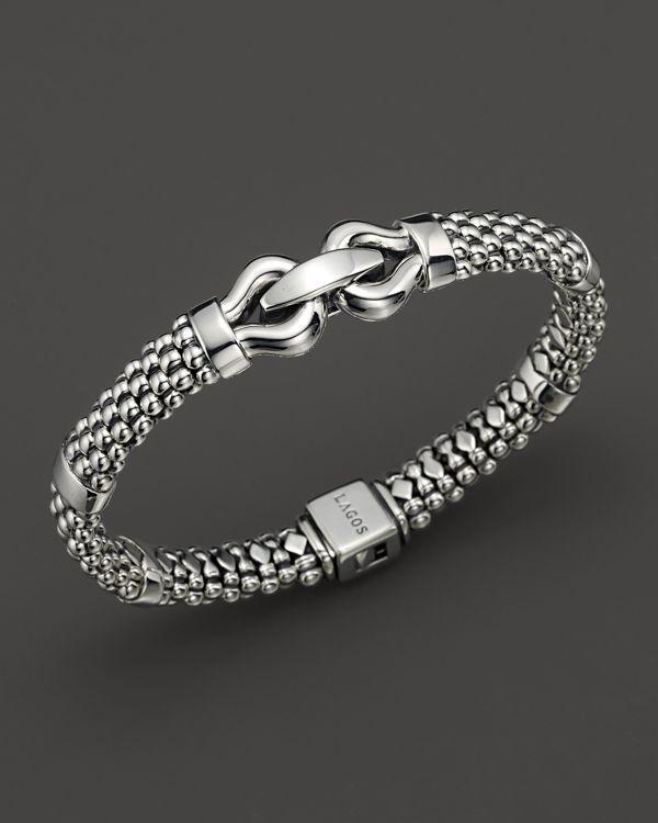 om silver rakhi designs