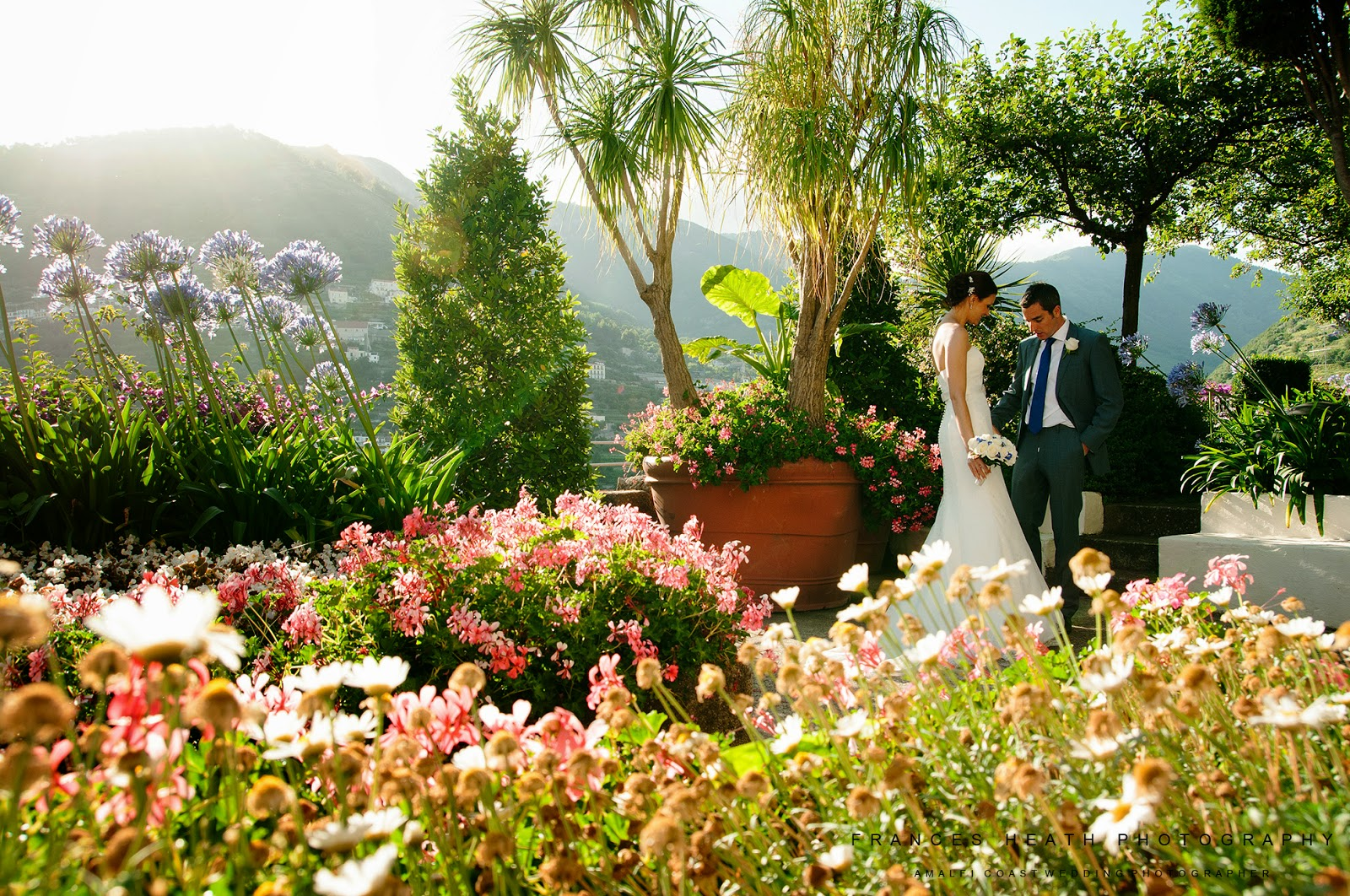 Bride and groom in Hotel Caruso gardens