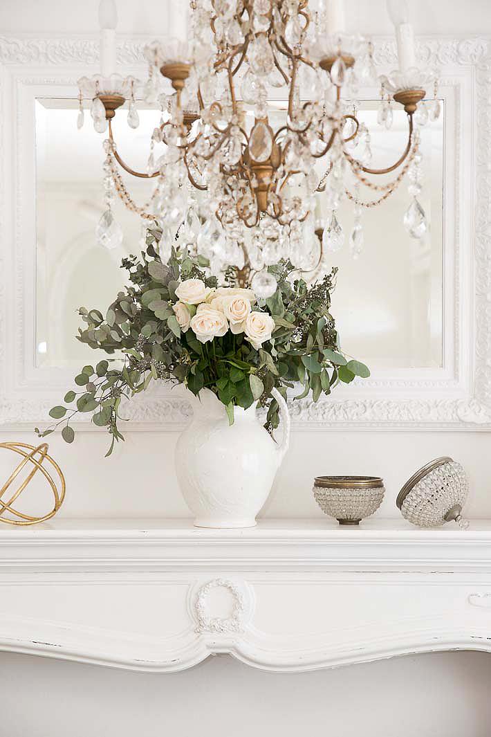 elegant white mantel with roses