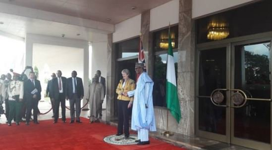 UK Prime Minister Arrives Nigeria, Received By Buhari In Aso Rock