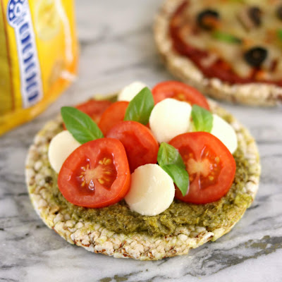 Real Foods Sorghum Thins with Pesto and Caprese Salad - Healthy Rice Cake Topping Ideas Recipes - Cherry Tomatoes, Bocconcini and Basil Leaves