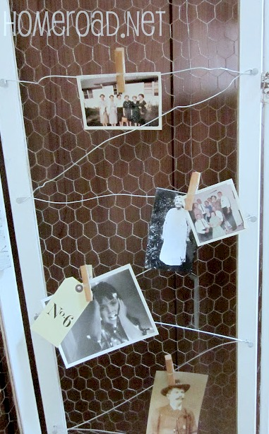 Photo display using wire on a chicken wire divider.