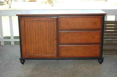 A $20.00 Goodwill dresser gets a major update with a few coats of paint and fun new knobs. www.littlehouseoffour.com
