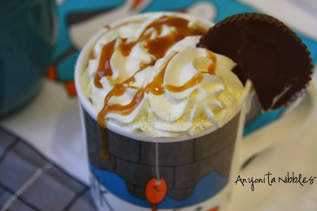 Peanut butter cup cocoa with whipped cream and toffee sauce from www.anyonita-nibbles.com