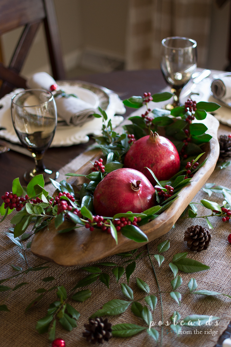 So beautiful! I love this Christmas centerpiece using pomegranates and holly in an wooden dough bowl.