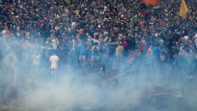 العراق تشتعل, حظر التجوال, اتساع رقعة المظاهرات, حصيلة القتلى, المتظاهرين, امراة خرساء توزع المناديل,