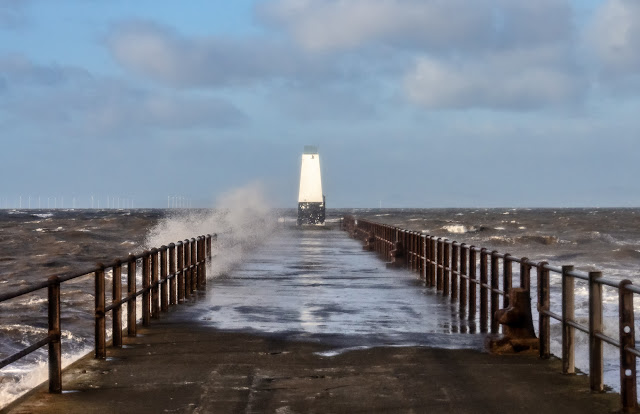 Photo of spray being blown across Maryport pier by high winds