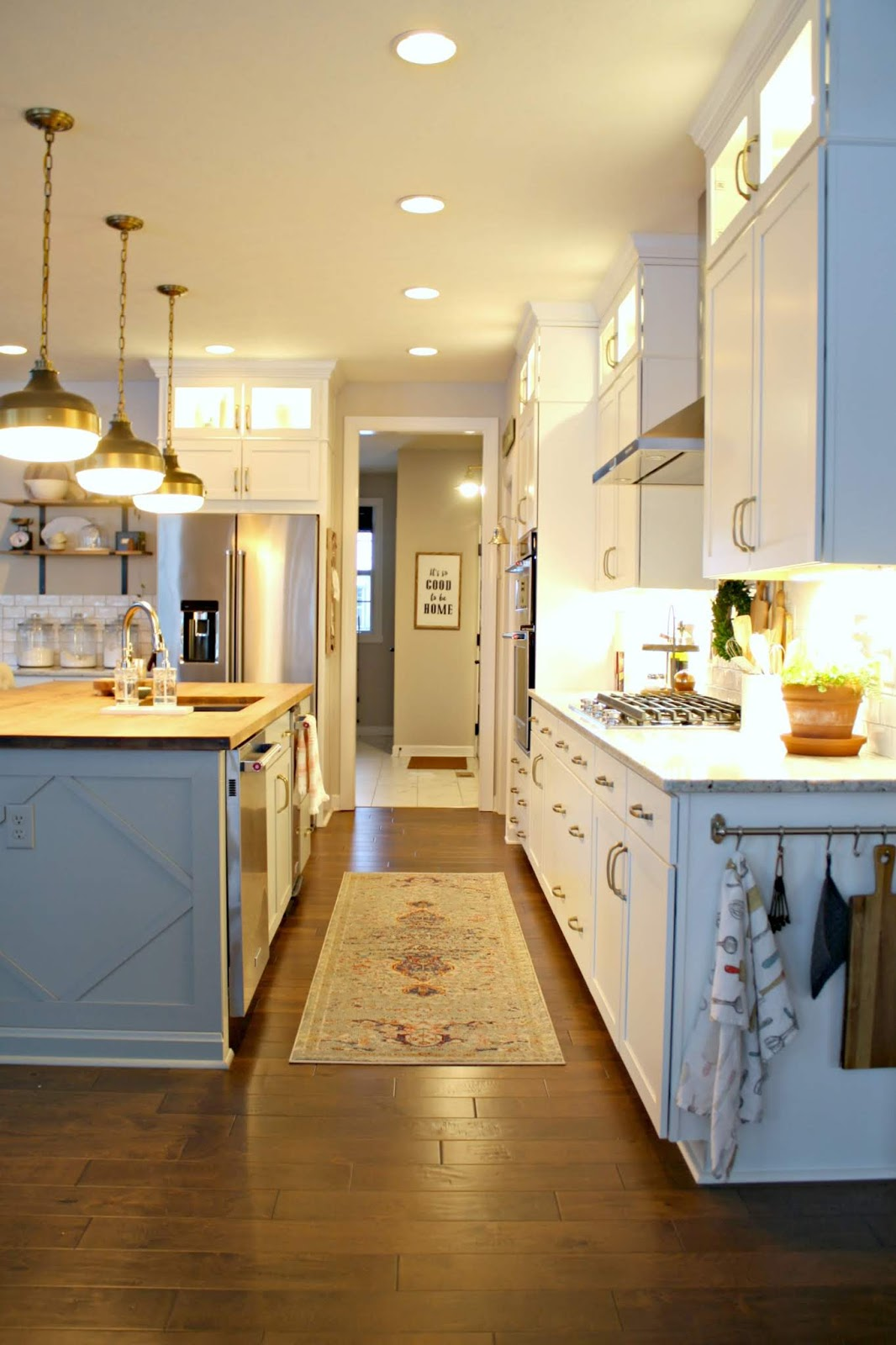Long kitchen with white cabinets