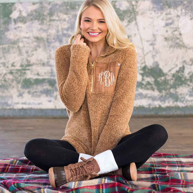 monogrammed camel sherpa pullover with leggings and duck boots on plaid blanket