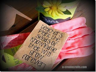 printable saying on kraft paper laying on pink gardening gloves