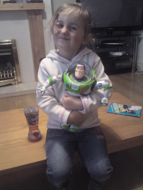 My youngest with her Buzz Lightyear