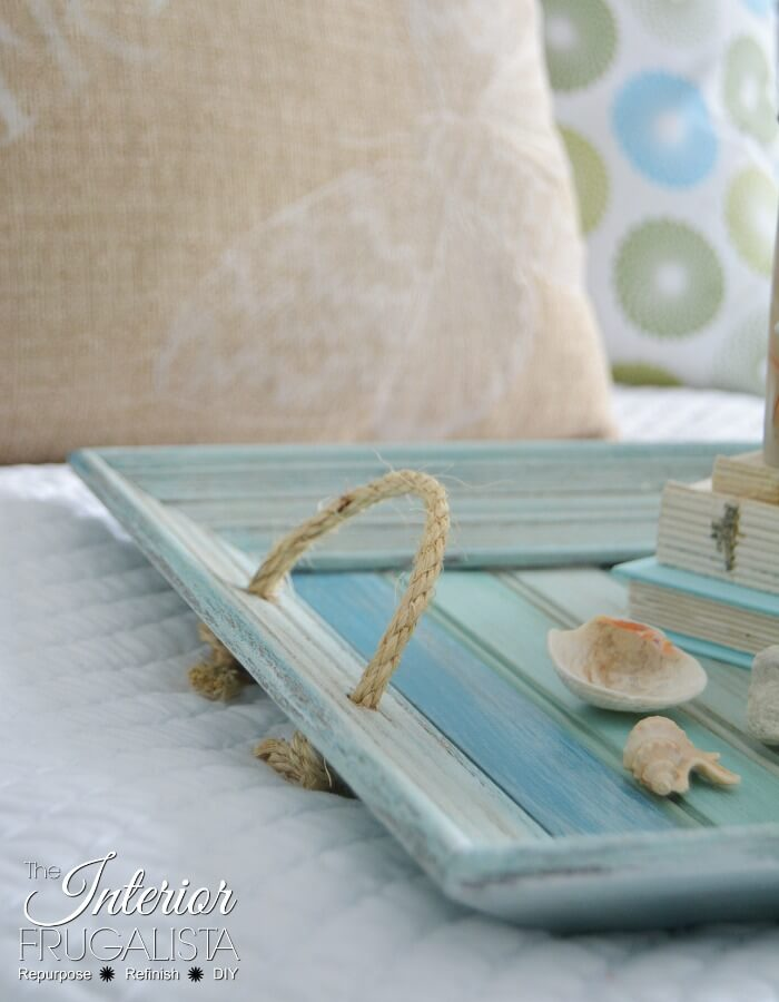 How to easily repurpose a picture frame into a handy serving tray for summer with wood slats painted pretty coastal colors and sisal rope handles.
