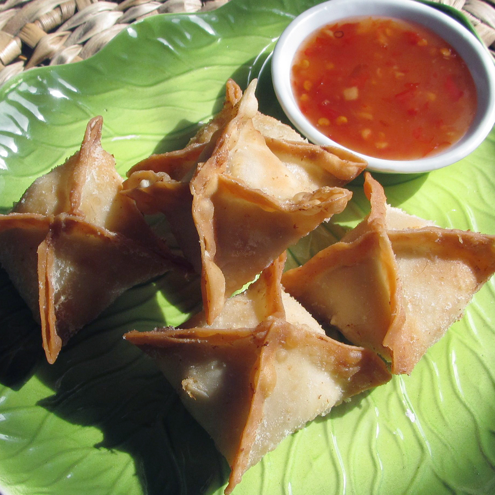 Crab Rangoon are crab and cheese-stuffed won tons. Make some for your next luau.