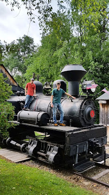 Interns stand on Shay Locomotive at PA Lumber Museum