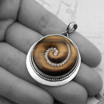 https://www.etsy.com/listing/100236476/swarovski-in-spiral-wrapped-sterling?ref=shop_home_active_2