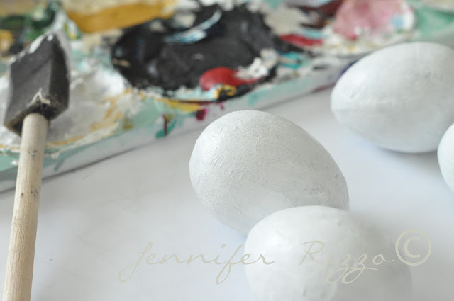 Painting and stampping paper mache eggs