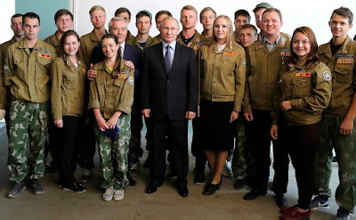 Vladimir Putin with members of a student construction brigade.