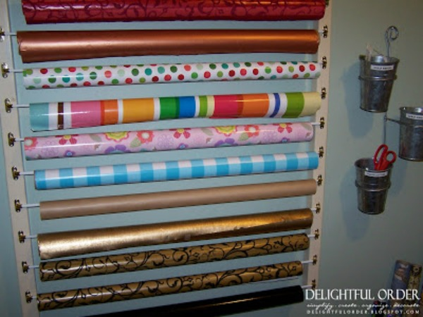 8. Sweet and simple: I love this wrapping station because it gives a great tutorial on how to hang large quantities of wrapping paper for a wonderful, neat appearance, and easy access anytime.