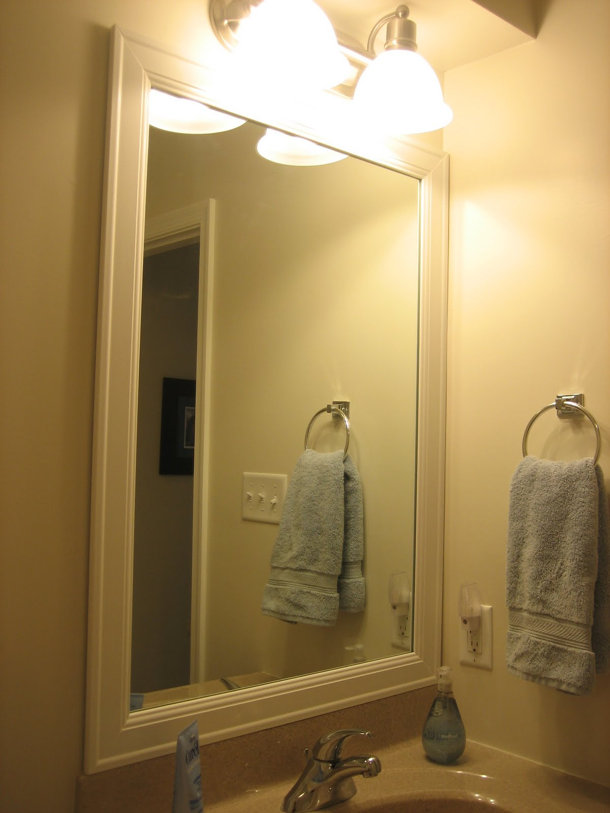 Elizabeth & Co.: Framing Bathroom Mirrors