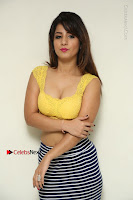 Cute Telugu Actress Shunaya Solanki High Definition Spicy Pos in Yellow Top and Skirt  0045.JPG