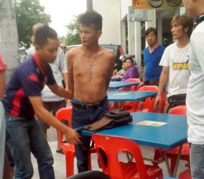 madman stabs man to death malaysia