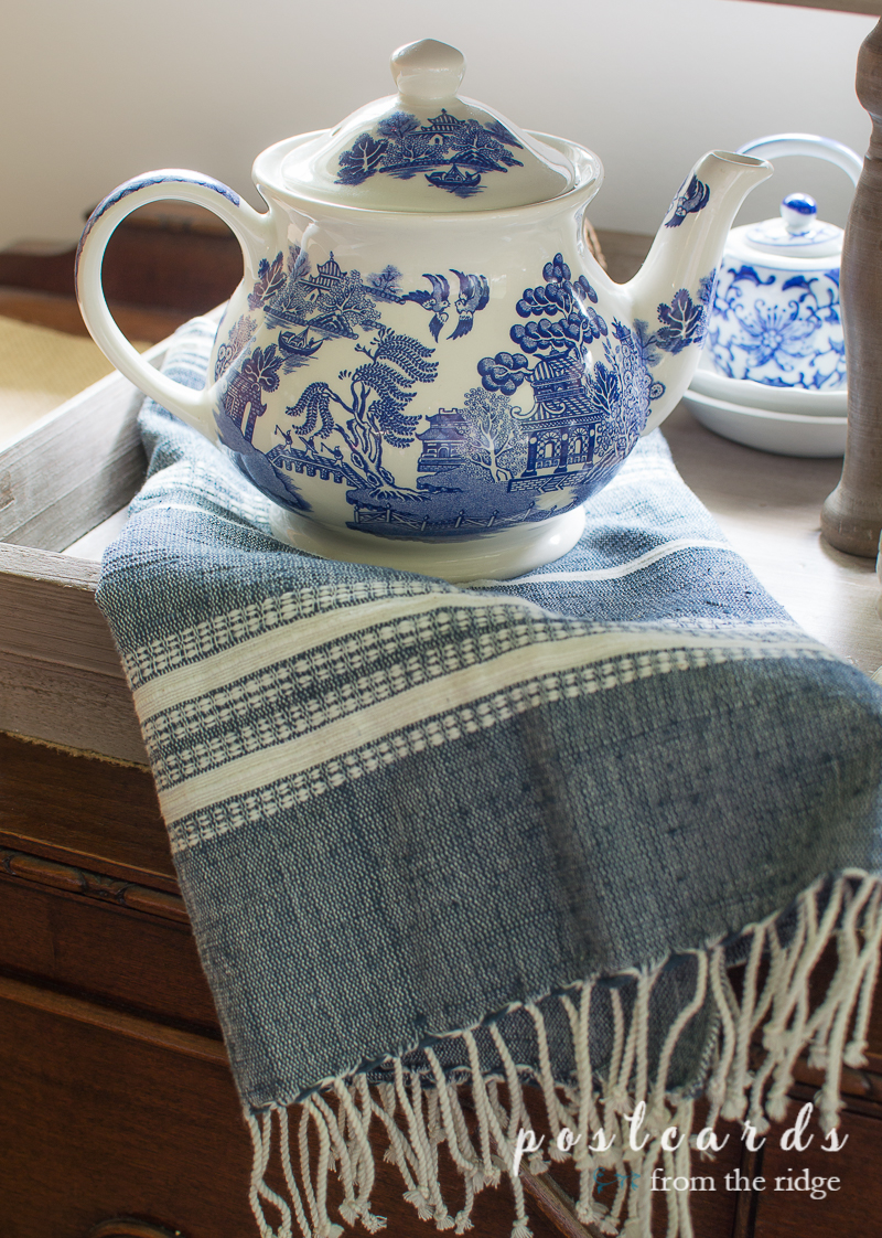 blue willow tea pot and woven hand towel