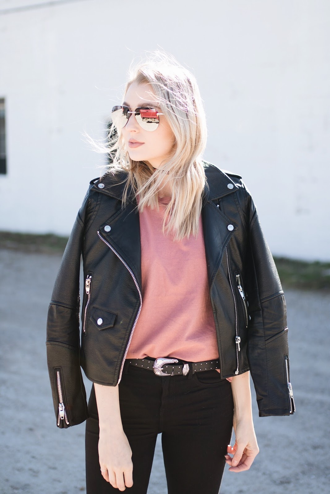 Faux leather jacket over a simple tee
