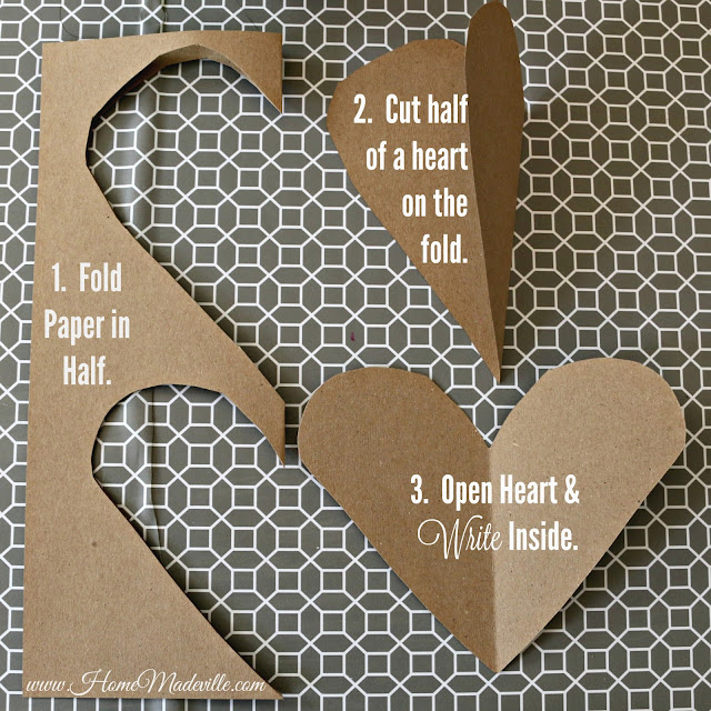 how to cut hearts from paper by folding in half and cutting half a heart at the fold.
