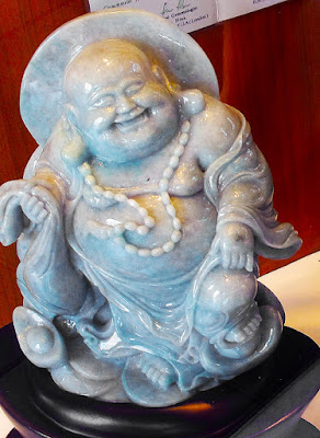 a beautiful carved jade laughing white Buddha