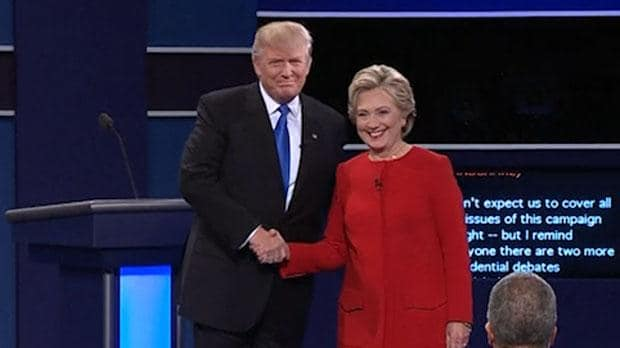 Donald Trump shaking hands with Hillary Clinton